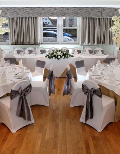 Wedding Breakfast with Blossoms Trees and Chair Covers